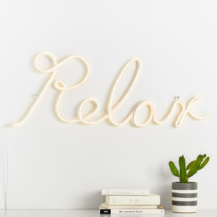 Relax neon in light yellow a pile of books striped pot with succulent