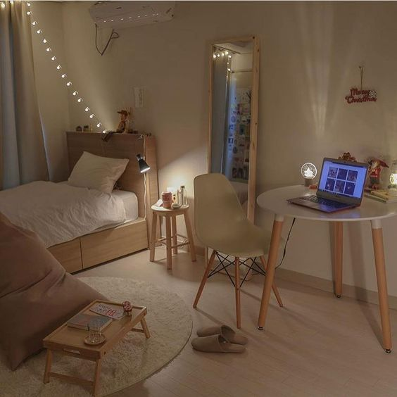 Scandinavian style teen bedroom light wood bed frame with headboard and hidden storage solution round top working desk Scandinavian style working chair beanbag in milo round shape rug in white