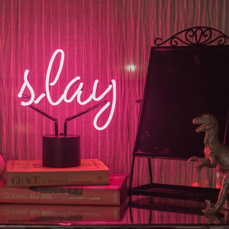 Slay radiant neon in pink with black stand and branches