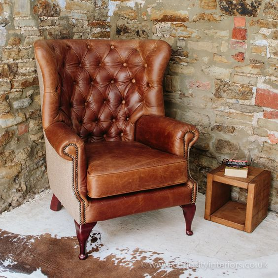 Tudor leather armchair with tufted backrest and tweet wings