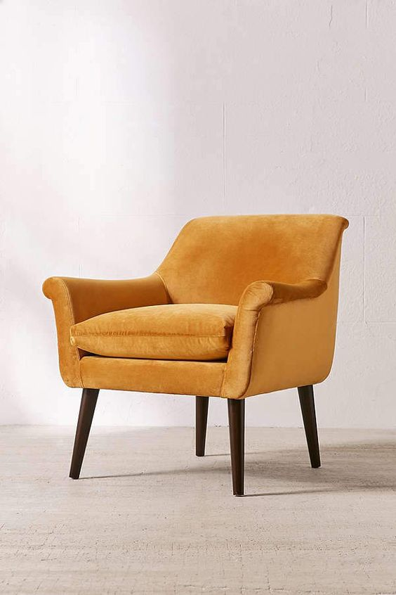 Urban Outfitters' armchair with curved arms removable cushion seat and espresso pine finish leg