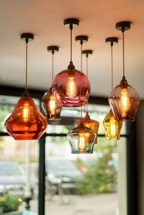 a cluster of pear drop pendants with heat proof glass lampshade in various color