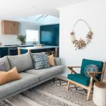 Beach Style Living Room Midcentury Modern Sofa In Gray Midcentury Modern Chair With Deep Turquoise Cushions Light Tone Log Stool Suculent On Pot