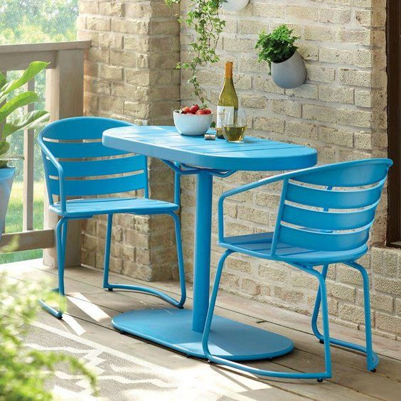 bistro table and chairs in bright blue hue