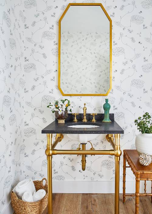 black granite countertop deep sink brass vanity's frame light wallpaper with classic floral patterns wood floors