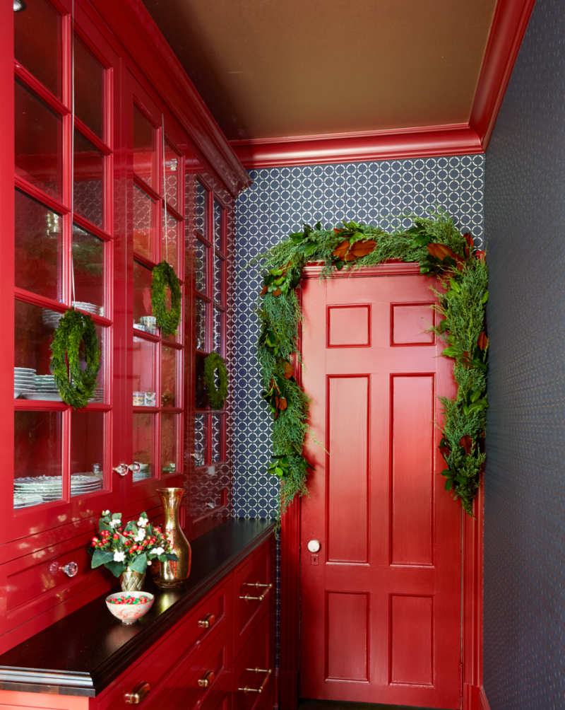 bronze ceilings bold red buffet with glass doors and brown countertop red door panel with green ornaments blue wallpaper