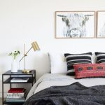 Chic Bedroom Patterned Pillows Animal Photograph With Brass Frame Modern Black Bedside Table Black Blanket