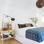 Clean Line Bedroom White Crisp Wall Painting Light Wood Floors Blue Patternen Blanket Patterned Rug Morocan Pendant In Dark Color Wood Side Table