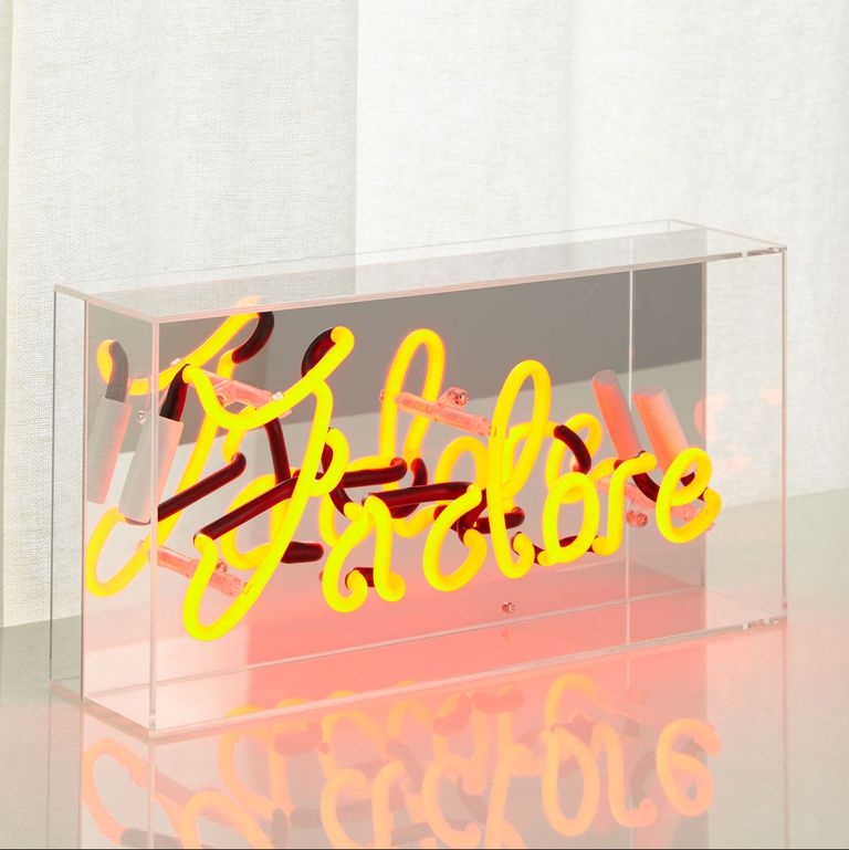 clear acrylic wrapped J'adore neon sign in yellow