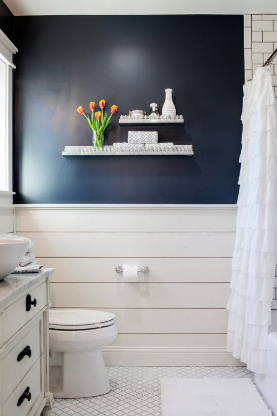 country style bathroom navy blue wall featuring wood planked walls white mosaic tile floors floating rack white shower curtains