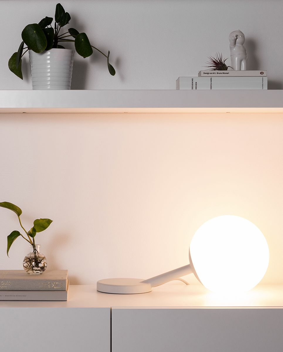 floating table lamp with white bulb and white stand