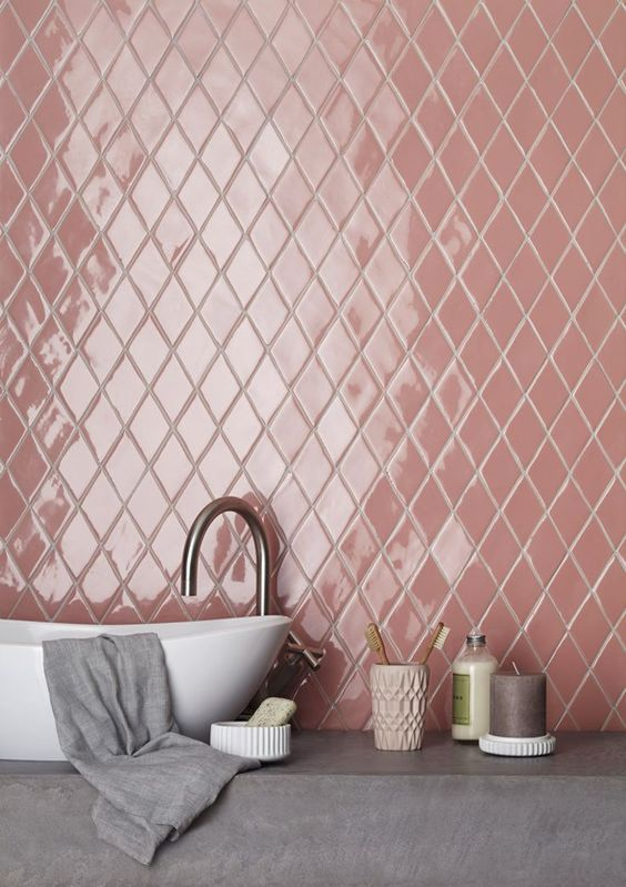 gloss pink tile walls made of ceramics white sink gray throw blanket concrete countertop