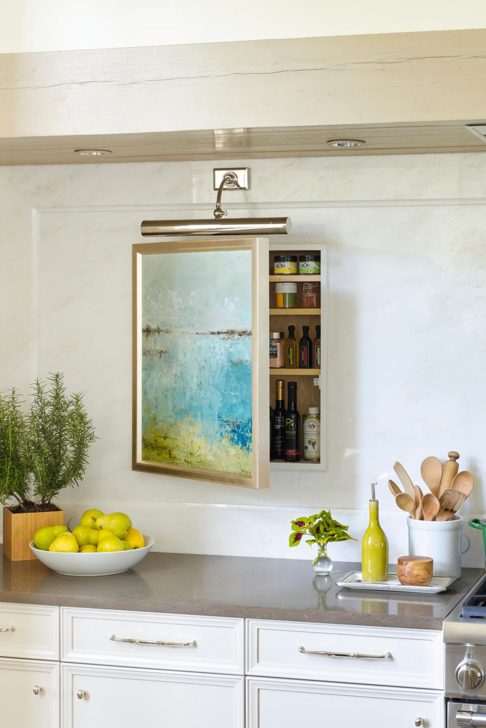 hidden storage solution with painted wall decor