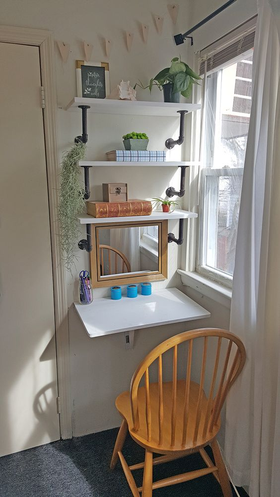 industrial shelving in white wood working chair glass window with dramatic white curtains