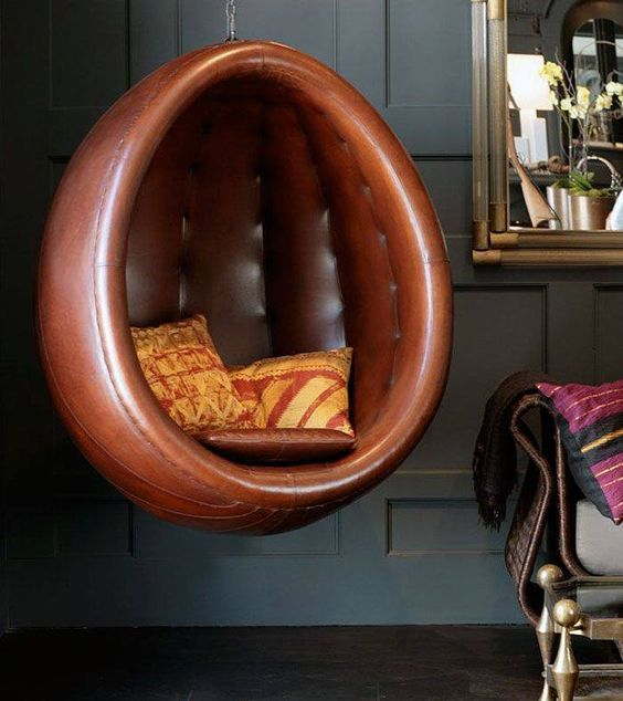 leather hanging egg chair with throw pillows