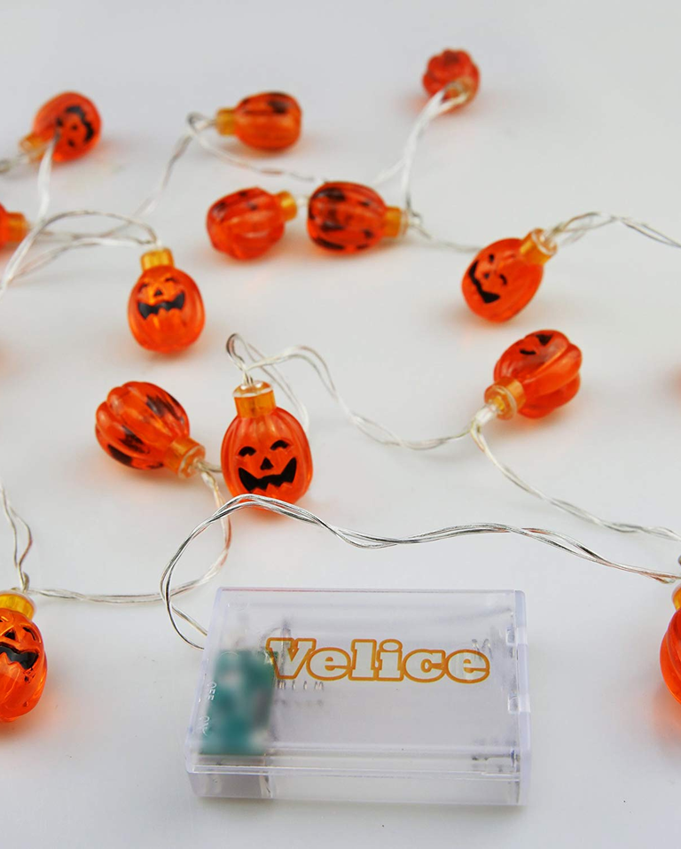 little carved pumpkin Halloween string lights with big grin