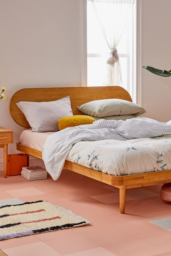 midcentury modern bed frame with raised oval headboard