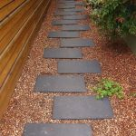 Minimalist Concrete Walkway With Small Stones Around