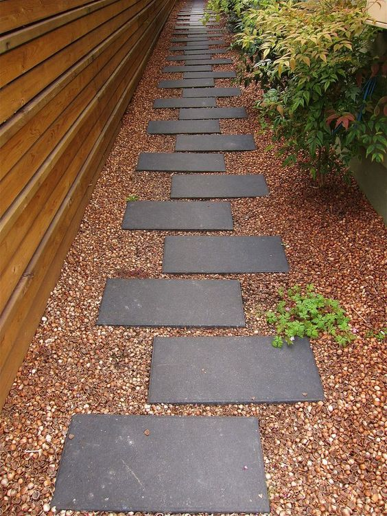 minimalist concrete walkway with small stones around