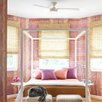Octagonal Bedroom With Multi Colors And Patterns Bed With Canopy Bright Pillows A Couple Of Benches