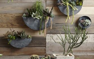 outdoor gallery wall consisting of wall mounted planters