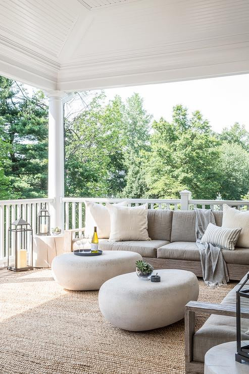 plush sofa in white two coffee tables in white outdoor floor light fixtures juted rug