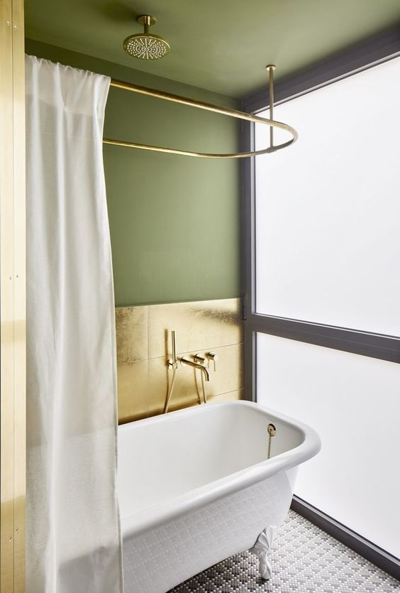 sage green walls and ceilings gold tone tile walls white bathtub white shower curtains with gold tone piping mosaic tile floors in white