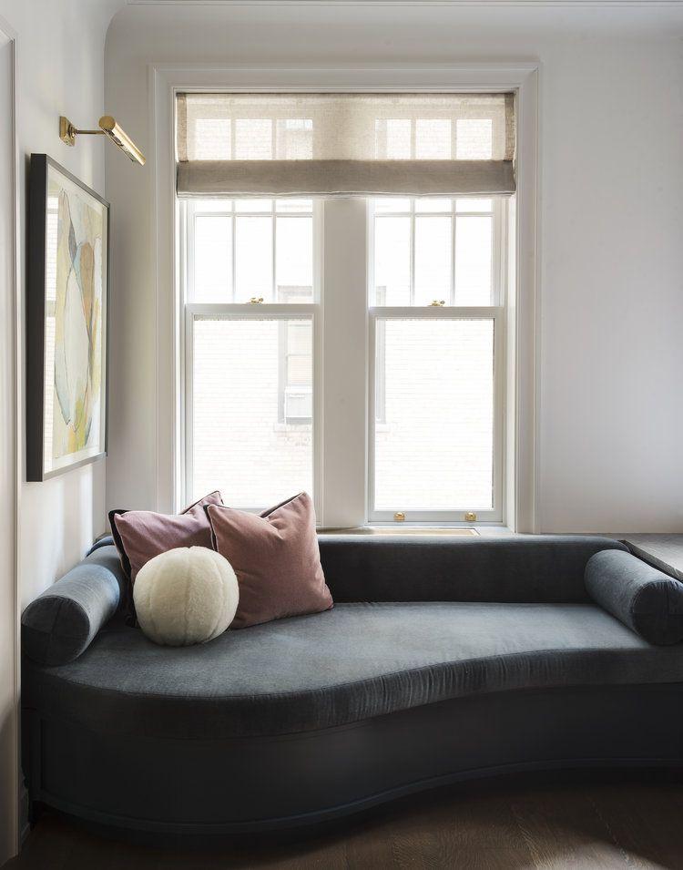 small reading corner idea velvet upholstery chaise in dark blue soft purple throw pillows ball shape throw pillow white trim window