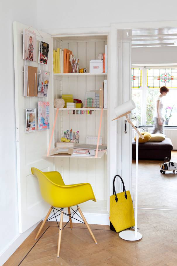 smart hidden shelves with pull out panel as a working desk scandinavian style chair in bright yellow