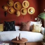 Straw Boater Wall Decor Dark Red Walls White Sofa With Throw Pillows Round Top Wood Tables