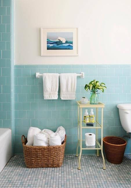 subway tile walls in blue mosaic tile floors woven basket high profile basic table in white white walls