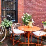Tiny Patio Idea Bright Orange Outdoor Dining Furniture