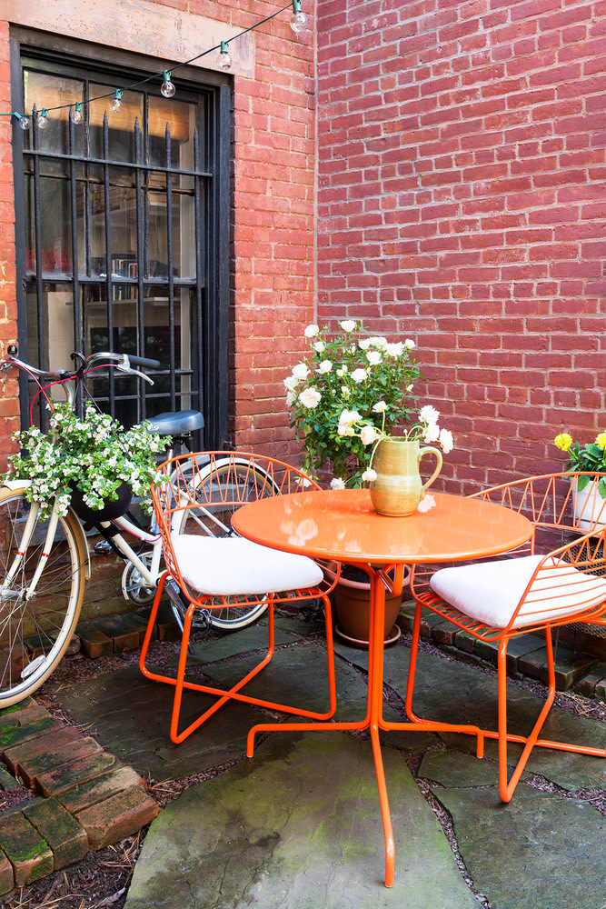 tiny patio idea bright orange outdoor dining furniture