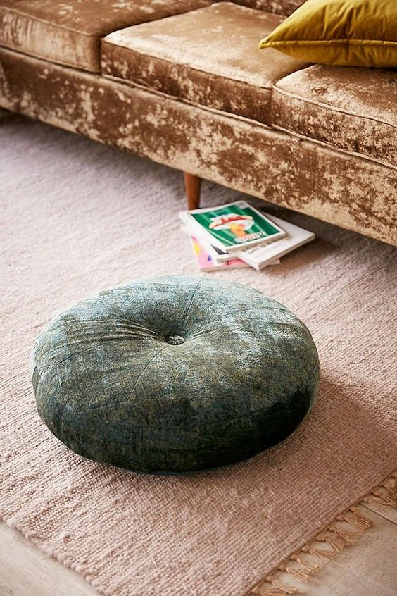 velvet pouf in green
