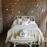 Winter Theme Bedroom Decor Idea Made Of Strings Of Christmas Light And Dried Branches