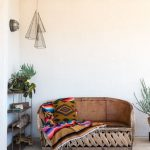 Wood Bench Seat With Crossed Wood Pad Base And Leather Like Backrest Juted Rug Ethnic Throw Blanket
