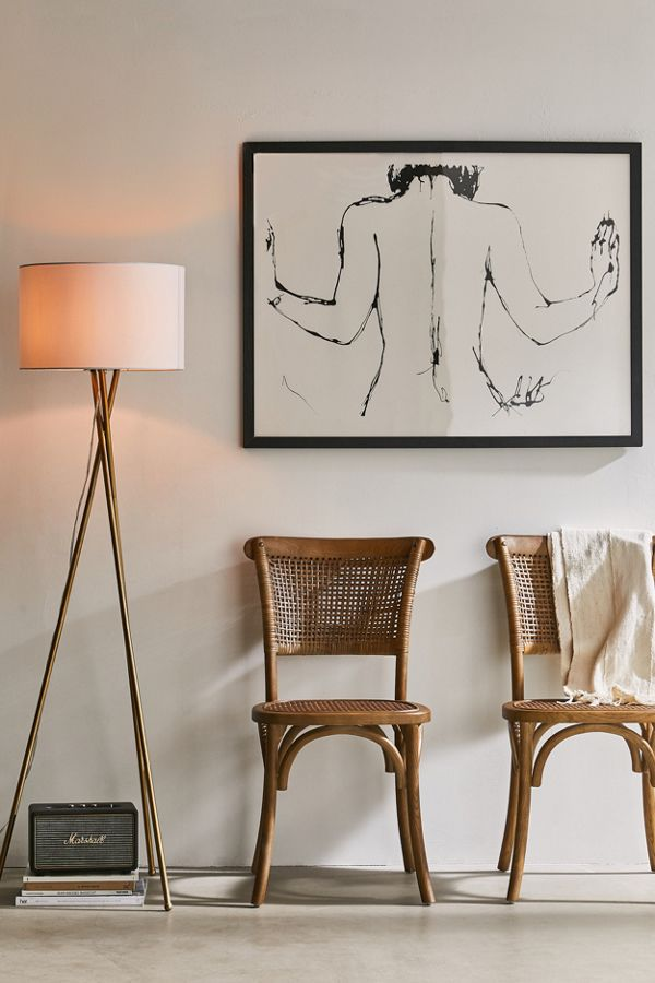 woven rattan chairs with curved legs and arched bars minimalist floor lamp with white lampshade