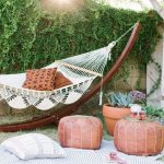 Boho Garden Idea Layered Fabric Rugs In Stripe Brown Poufs Boho Style Swing With Wood Supporter