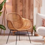 Lillian Cage Like Chair Made Of Rattan And Supported With Tiny Metal Legs