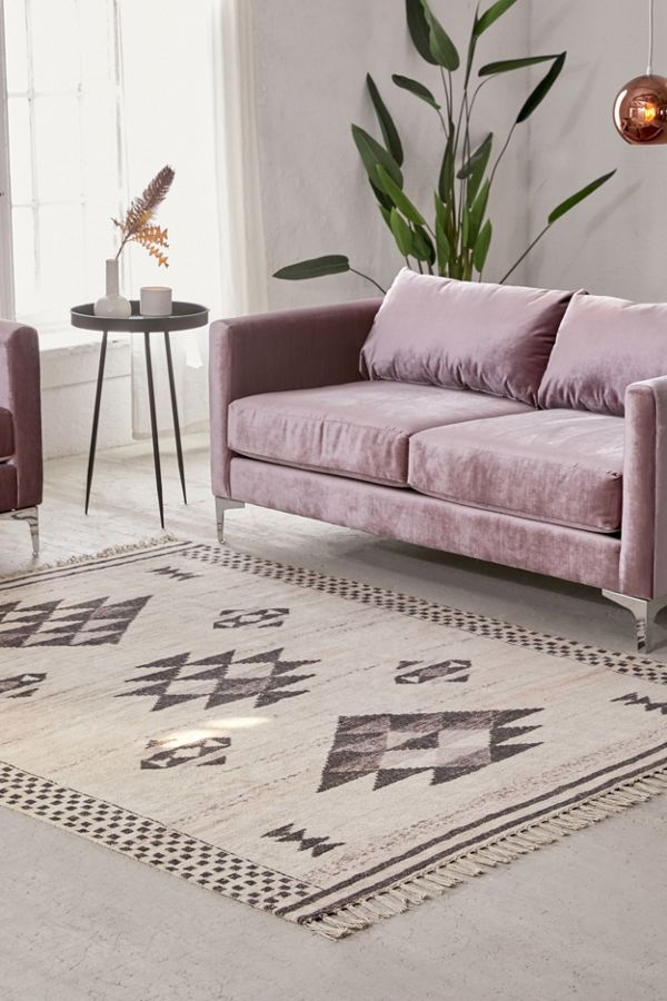 Sabira area rug in gray accented with geometric prints and tassel trims