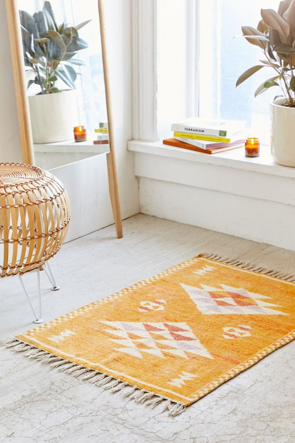 Sabira rug in yellow pop with white geometric motifs and tassel trims on both base edges
