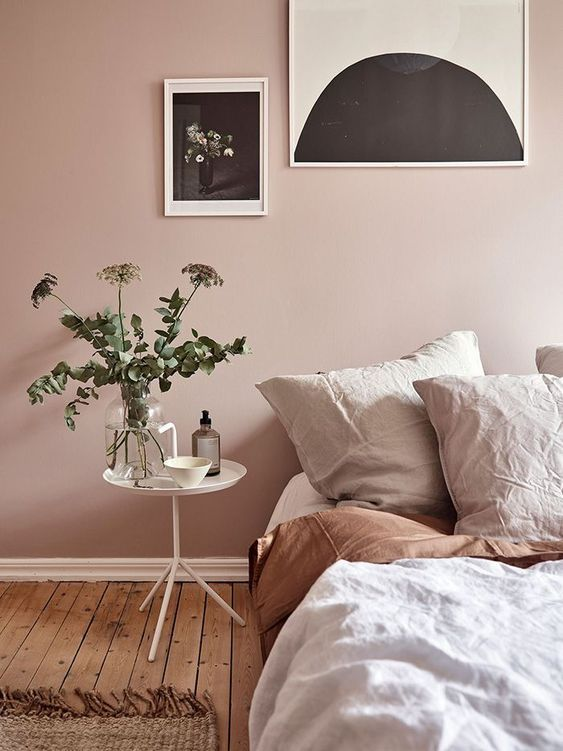 baby pink bedroom wall idea round top bedside table in white wood plank floors