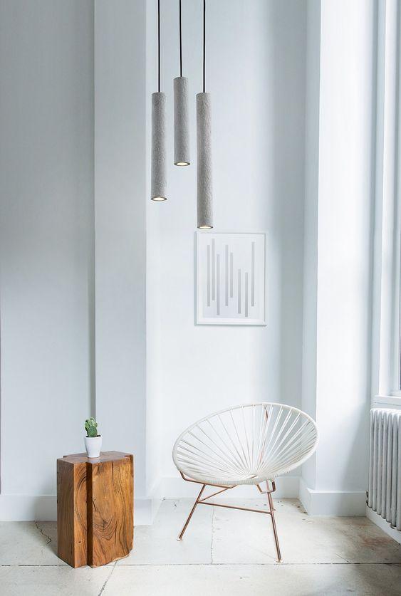 brightly white sitting corner modern white egg chair wood side table white walls white tile floors