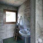 Concrete Walls And Ceilings Deep Green Tile Floors Wood Ladder Standing Sink Glass Window With Wood Frame