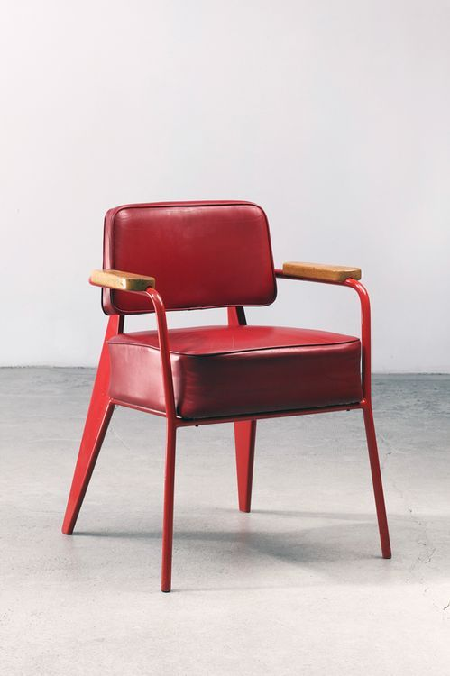 dramatic red chair with leather upholstery