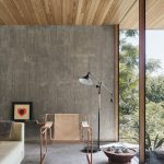 Dreamy Living Room With Raw Concrete Wall And Smoot Concrete Floors Wood Plank Ceilings Metallic Chair Tufted Shag Rug In White Black