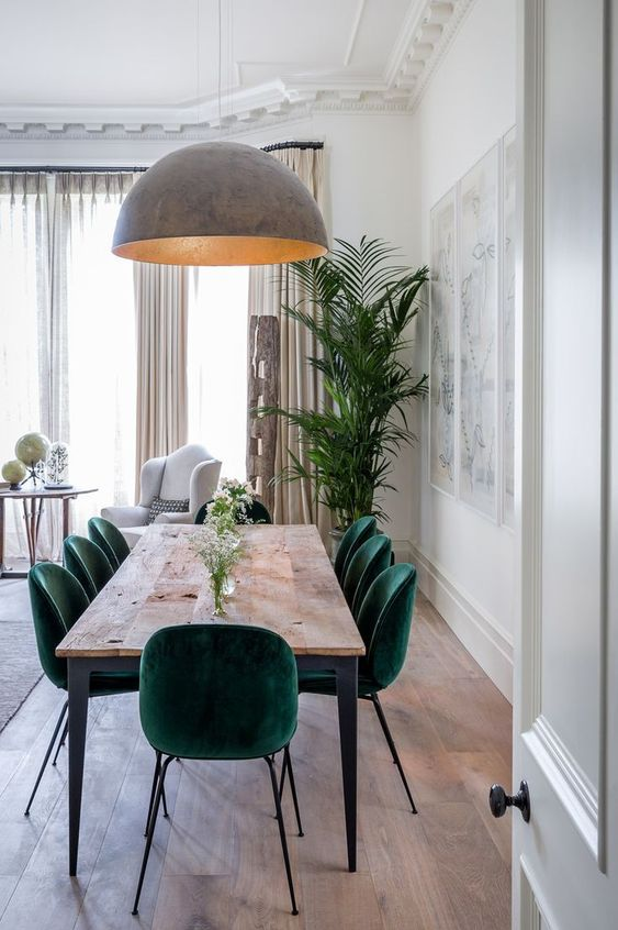emerald green velvet upholstered dining chairs solid wood dining table oversized pendant lamp