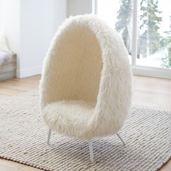 fur cave like chair in white with angled legs