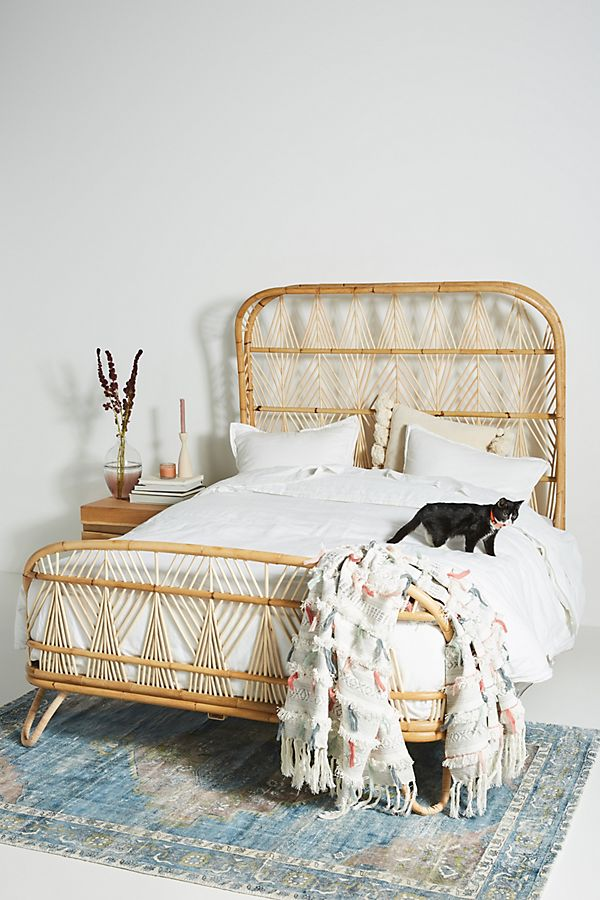 hancrafted rattan bed frame with headboard by Anthropologie
