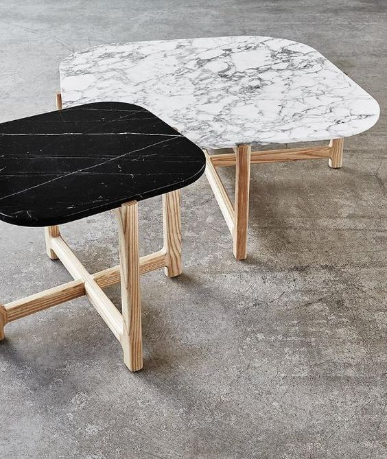marble top coffee table with semi curved edges and natural wood legs